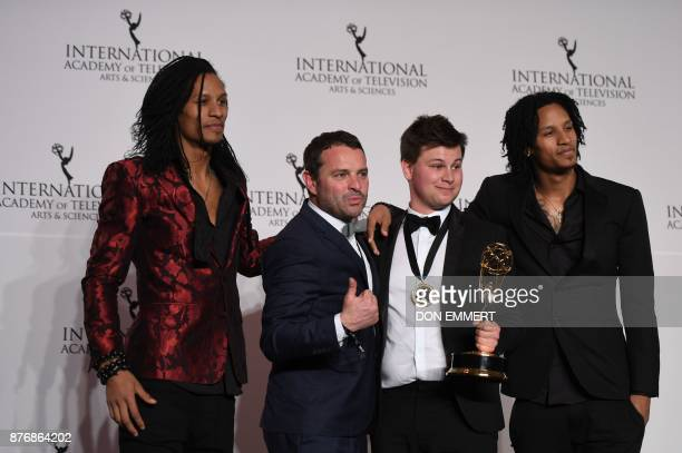 Wim Janseen and Kamiel De Bruyne pose with the award for Best NonScripted Entertainment as Les Twins look on at the 45th International Emmy awards...