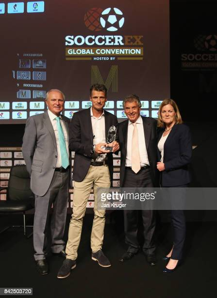 Wim Jonk Cruyff Football CEO accepts the Duncan Revie award on behalf of Johan Cruyff of the Netherlands with Tony Martin Soccerex Chairman David...