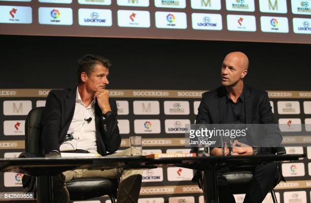 Wim Jonk Cruyff Football CEO talks with Jordi Cruyff Maccabi Tel Aviv FC Head Coach during day 1 of the Soccerex Global Convention at Manchester...