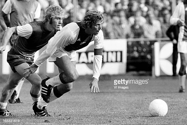 Wim Rijsbergen of Feyenoord Piet Keizer of Ajax during the Dutch Eredivisie match between Ajax and Feyenoord at De Meer on november 23 1973 in...