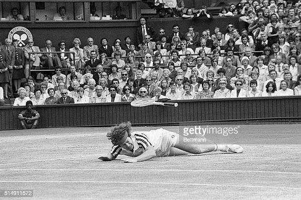 The Men's Singles final John McEnroe falls to the ground in a heavy fall and his racket goes flying during his battle with Bjorn Borg of Sweden Borg...