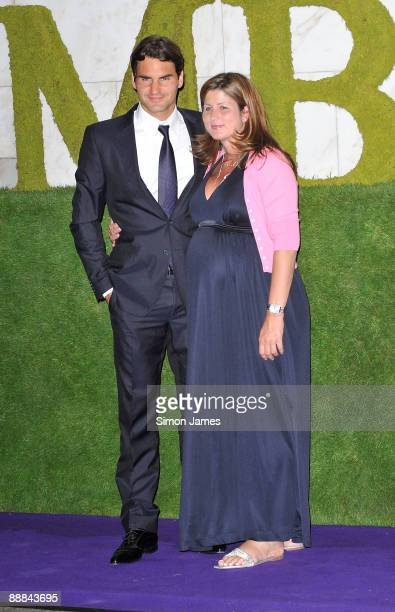 Wimbledon 2009 men's singles champion Roger Federer and his wife Mirka Federer attend the Wimbledon Winners Party at Hotel Intercontinental on July 5...