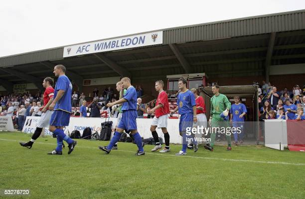 Wimbledon and FC United players walk out before the preseason friendly match between AFC Wimbledon and FC United of Manchester at The Fans' Stadium...