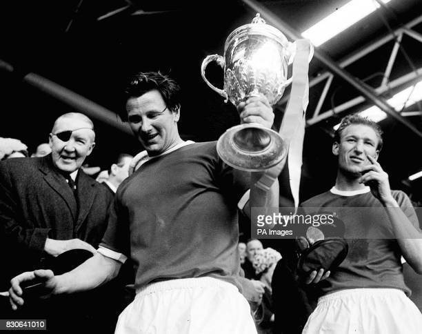 Wimbledon captain Roy Law who proudly collects the FA Amateur Cup after they beat Sutton United 42 during the final at Wembley Stadium London