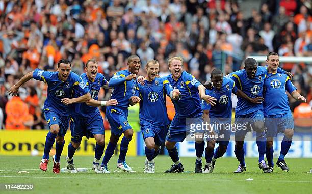 Wimbledon celebrate winning the penalty shootout of the Blue Square Bet Premier League Play Off Final between AFC Wimbledon and Luton Town at City of...