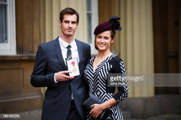 Wimbledon champion Andy Murray and his girlfriend Kim Sears pose at Buckingham Palace on October 17 2013 in London England Murray was awarded the...