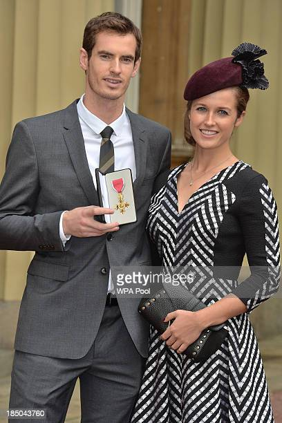 Wimbledon champion Andy Murray and his long time girlfriend Kim Sears pose at Buckingham Palace on October 17 2013 in London England Murray was...