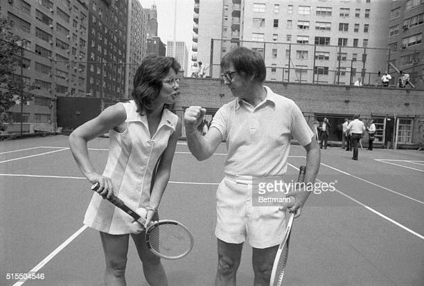 Wimbledon champion Billie Jean King tactfully holds down the net so that 55yearold Bobby Riggs can easily clear it during meeting at an east side...
