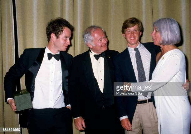 Wimbledon champion John McEnroe of the USA with his father John Patrick Senior his brother Patrick and mother Katherine at the Wimbledon Champions...