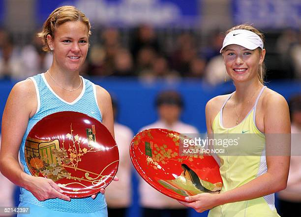 Wimbledon champion Maria Sharapova of Russia holds up the winner's trophy of the Pan Pacific Open tennis tournament as she poses along with Lindsay...