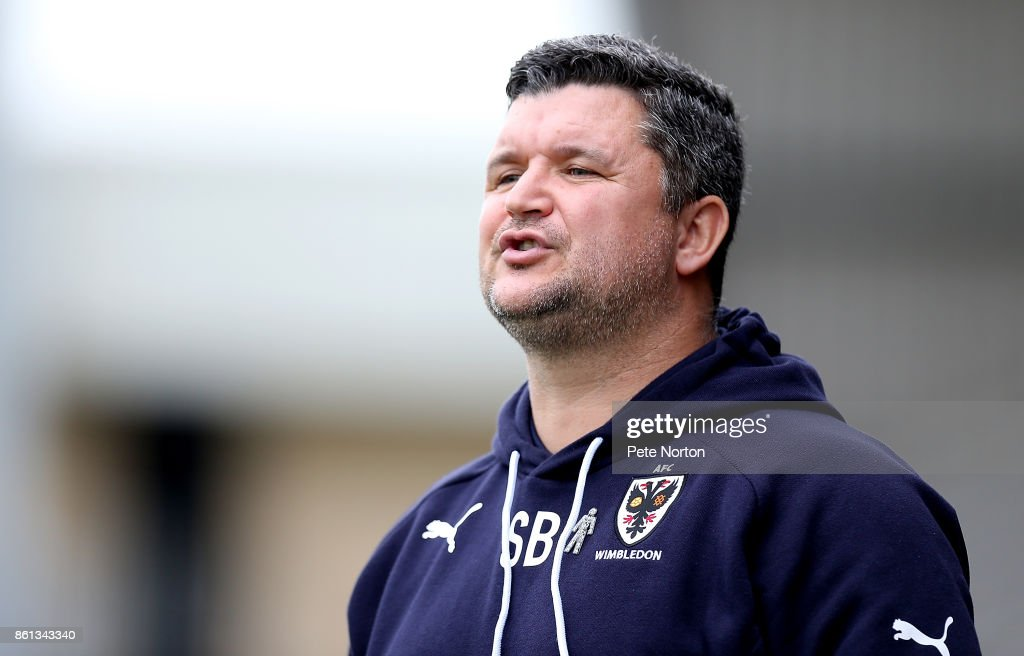 AFC Wimbledon coach Simon Bassey looks on during the Sky Bet League One match between Northampton Town and A.F.C. Wimbledon at Sixfields on October 14, 2017 in Northampton, England.