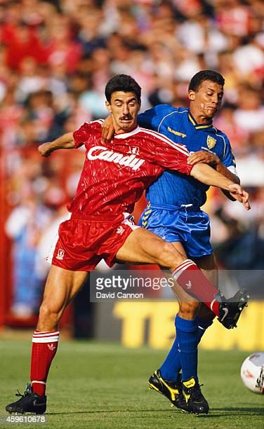 Wimbledon defender Keith Curle challenges Liverpool forward Ian Rush during a League Division One match between Wimbledon and Liverpool at Plough...
