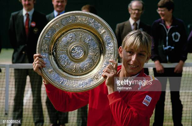 Martina Navratilova lifts the Women's Singles Trophy after her victory at Wimbledon