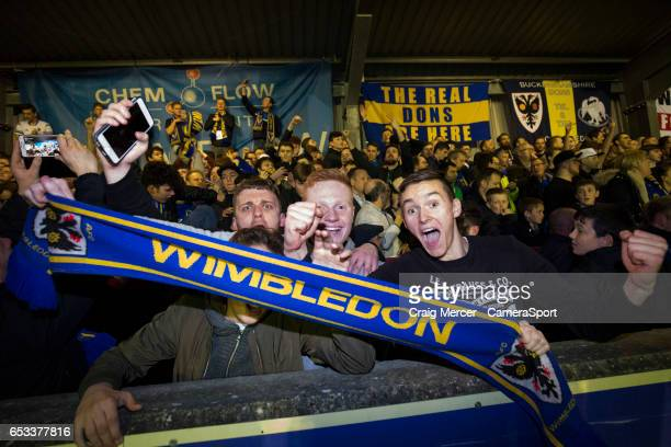Wimbledon fans celebrate their sides victory after the Sky Bet League One match between AFC Wimbledon and Milton Keynes Dons at The Cherry Red...