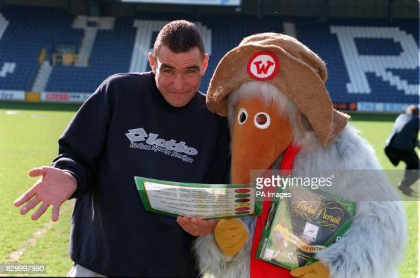 Wimbledon FC's Vinnie Jones and one of Wimbledon Common's Wombles launch the Trivial Pursuit World Cup Edition at QPR's stadium in South Africa Road...