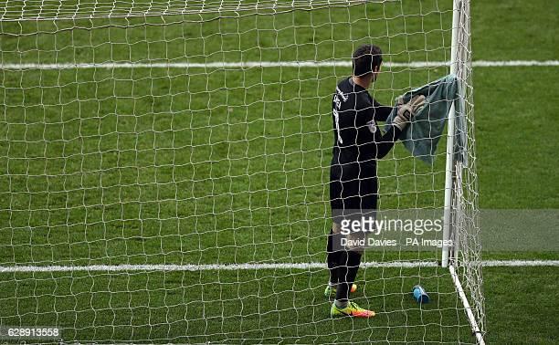 AFC Wimbledon goalkeeper James Shea dries his gloves during the Sky Bet League One match at Stadium mk Milton Keynes