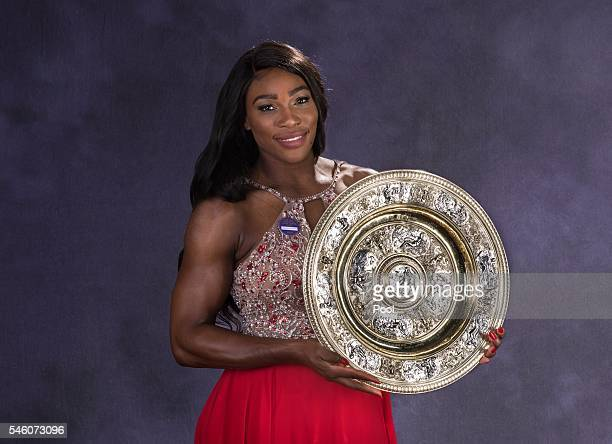 Wimbledon ladies singles Tennis Champion Serena Williams of the United States poses with the trophy at the Wimbledon Champions Dinner 2016 at the...