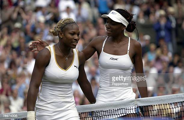 Wimbledon Lawn Tennis Championships London England 6th July 2002 Ladies Singles Final Venus Williams of the USA puts an arm around her sister Serena...