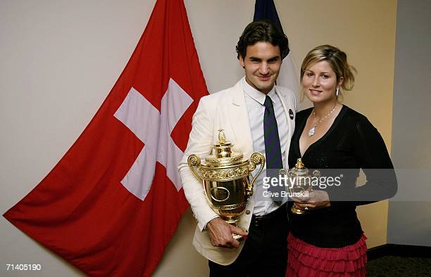 Wimbledon Mens Singles Champion Roger Federer of Switzerland poses with his trophy and girlfriend Mirka Vavrinec at the Wimbledon Winners' Dinner at...