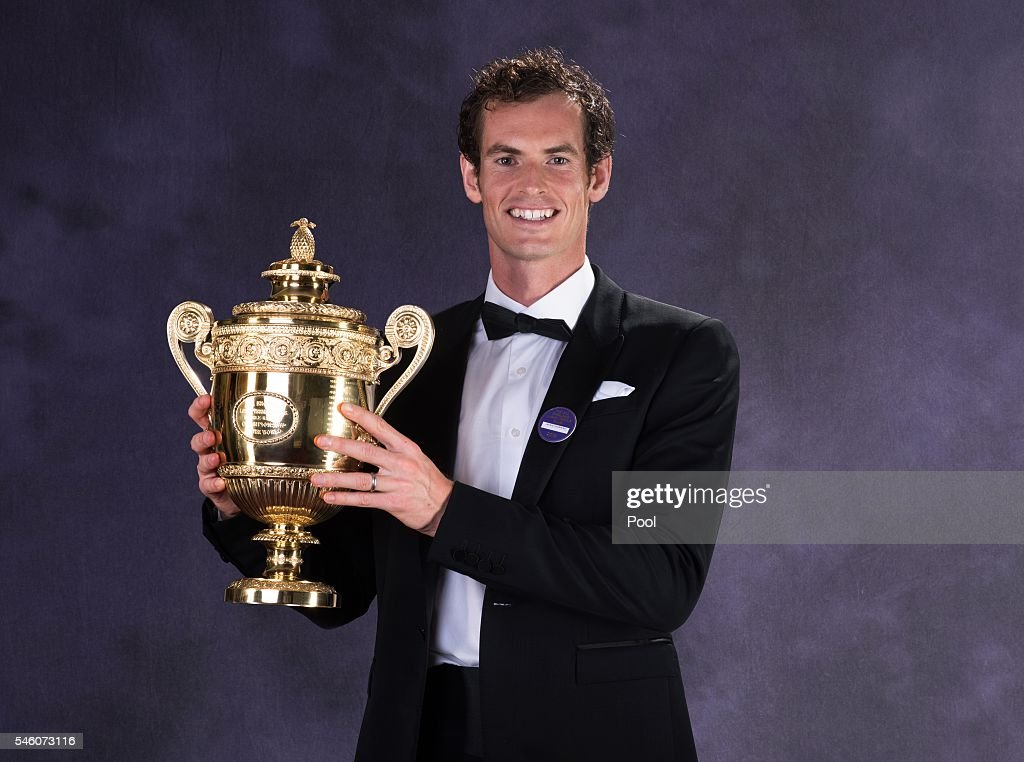 Wimbledon men's singles Tennis Champion Andy Murray of Great Britain poses with the trophy at the Wimbledon Champions Dinner 2016 at the Guild Hall...