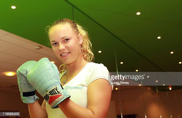 Wimbledon No 1 Seed Caroline Wozniacki of Denmark poses for a photograph in a boxercise class organised by COMPEED® for tennis fans during a COMPEED®...