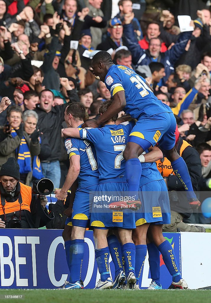 AFC Wimbledon players celebrate after Jack Midson had scored his sides goal during the FA Cup with Budweiser Second Round match between MK Dons and AFC Wimbledon at StadiumMK on December 2, 2012 in Milton Keynes, England.