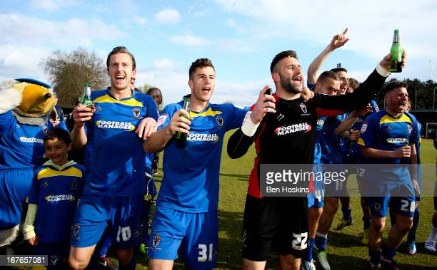 Wimbledon players celebrate after the final whistle during the npower League Two match between AFC Wimbledon and Fleetwood Town at the Cherry Red...