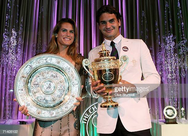 Wimbledon Singles Champions Roger Federer of Switzerland and Amelie Mauresmo of France pose with their trophies at the Wimbledon Winners' Dinner at...