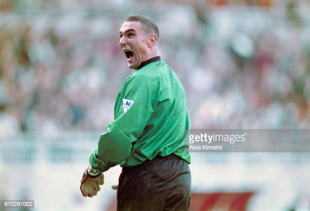 Wimbledon stand in goalkeeper Vinny Jones shares a joke with Newcastle fans in the Gallowgate end after taking over the gloves during the Premier...
