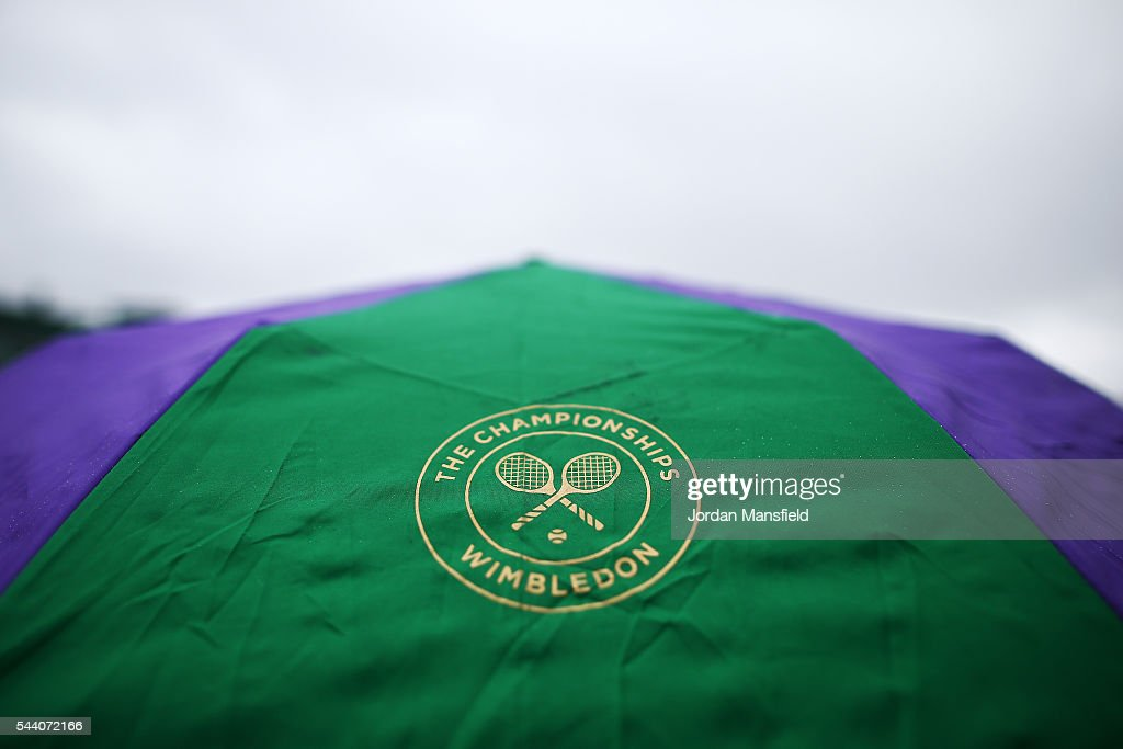 A Wimbledon umbrella is on show on day five of the Wimbledon Lawn Tennis Championships at the All England Lawn Tennis and Croquet Club on July 1, 2016 in London, England.