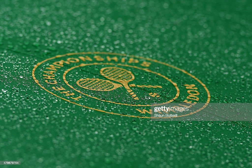 Wimbledon Umbrella is seen during a rain delay on day nine of the Wimbledon Lawn Tennis Championships at the All England Lawn Tennis and Croquet Club...