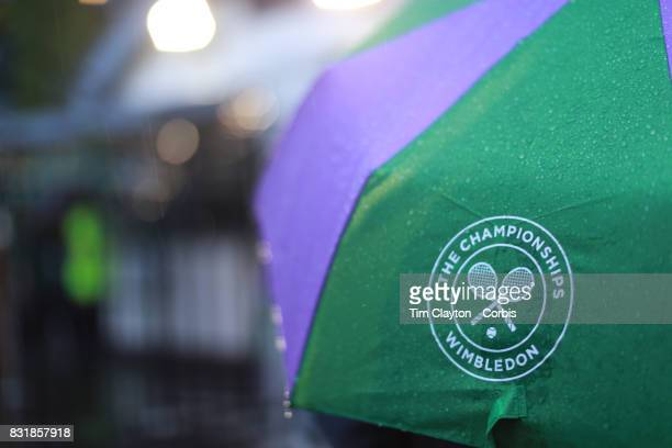 Wimbledon umbrellas during a rain shower at the Wimbledon Lawn Tennis Championships at the All England Lawn Tennis and Croquet Club at Wimbledon on...