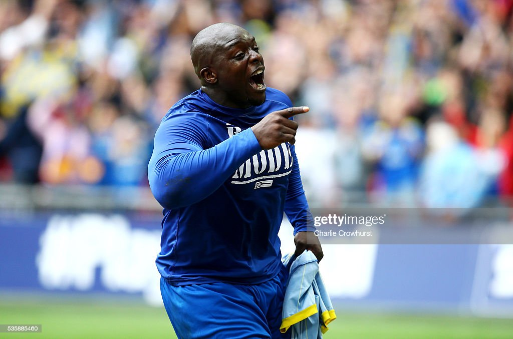 AFC Wimbledon's Adebayo Akinfenwa celebrates after scoring the teams second goal from the penalty spot during the Sky Bet League 2 Play Off Final between Plymouth Argyle and AFC Wimbledon at Wembley Stadium on May 30, 2016 in London, England.