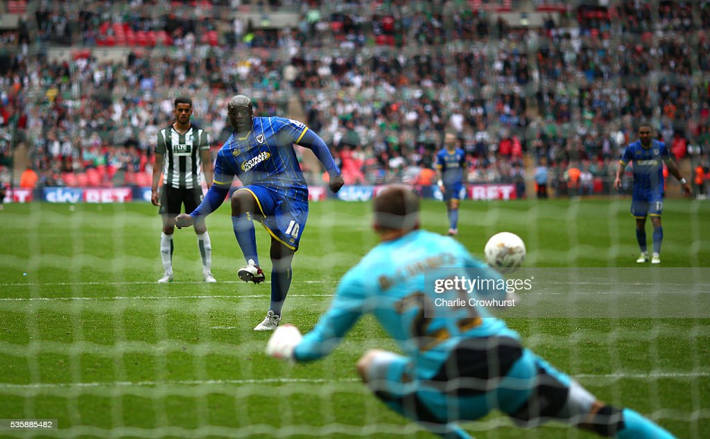 AFC Wimbledon's Adebayo Akinfenwa scores the teams second goal from the penalty spot during the Sky Bet League 2 Play Off Final between Plymouth Argyle and AFC Wimbledon at Wembley Stadium on May 30, 2016 in London, England.