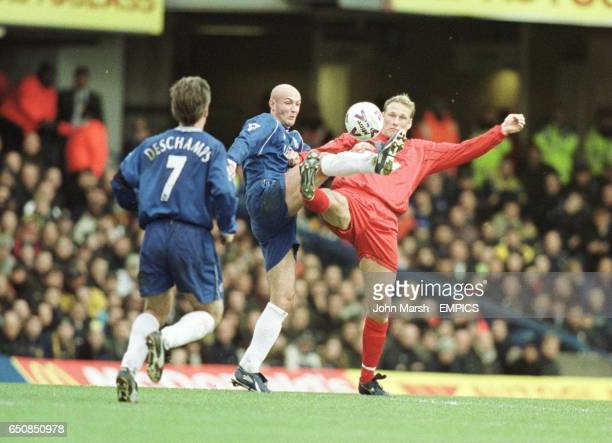 Wimbledon's Andreas Lund and Chelsea's Frank Leboeuf challenge for the ball