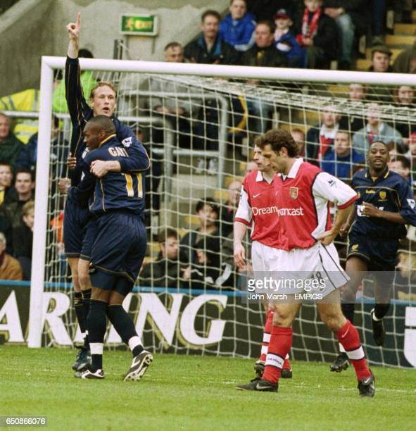 Wimbledon's Andreas Lund and Marcus Gayle celebrate Lund's opening goal as Arsenal's Gilles Grimandi looks on