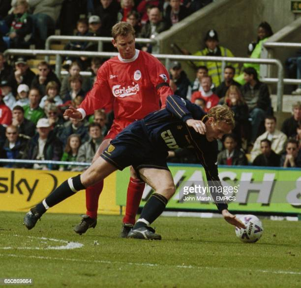 Wimbledon's Andreas Lund gets past Liverpool's Stephane Henchoz