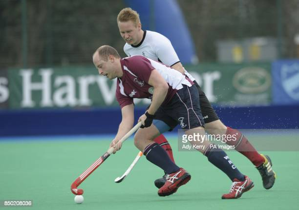 Wimbledon's Ben Hawes is challenged by Southgate's Andrew Westbrook during their NOW Pensions Men's Hockey League Playoff match at Sonning Lane...