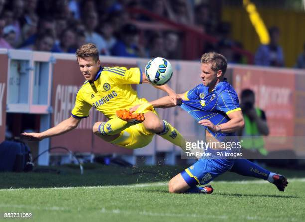 AFC Wimbledon's Dannie Bulman and Chelsea XI's Marco Van Ginkel challenge for ball during the PreSeason friendly at the The Cherry Red Records...