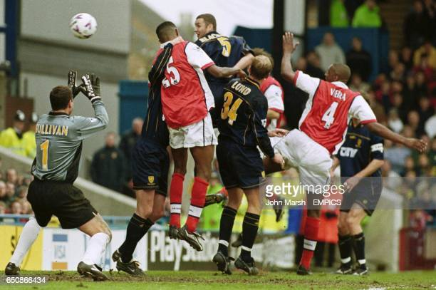 Wimbledon's Dean Blackwell Andreas Lund and Neil Sullivan are beaten by Arsenal's Nwankwo Kanu as he scores Arsenal's second goal