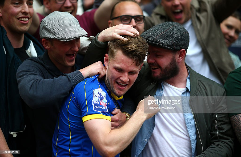 AFC Wimbledon's Jake Reeves celebrates the teams win and promotion with friends during the Sky Bet League 2 Play Off Final between Plymouth Argyle and AFC Wimbledon at Wembley Stadium on May 30, 2016 in London, England.