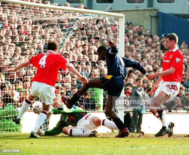 Wimbledon's John Fashanu forces through the Manchester United defence to put the ball past Peter Schmeichel for the only goal of the match at...