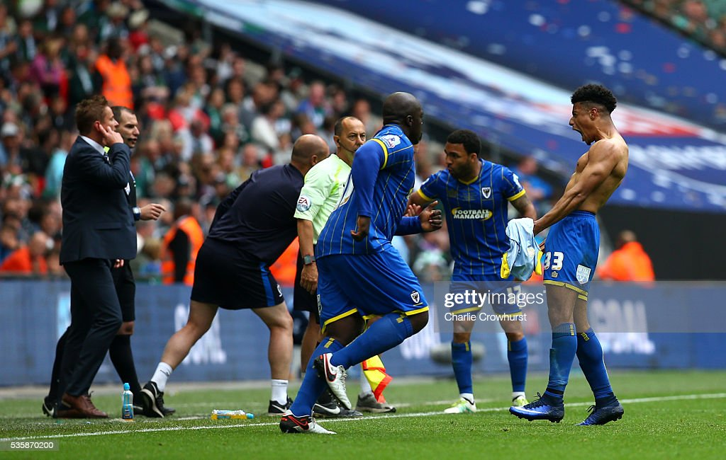 AFC Wimbledon's Lyle Taylor celebrates scoring the first goal of the game during the Sky Bet League 2 Play Off Final between Plymouth Argyle and AFC Wimbledon at Wembley Stadium on May 30, 2016 in London, England.