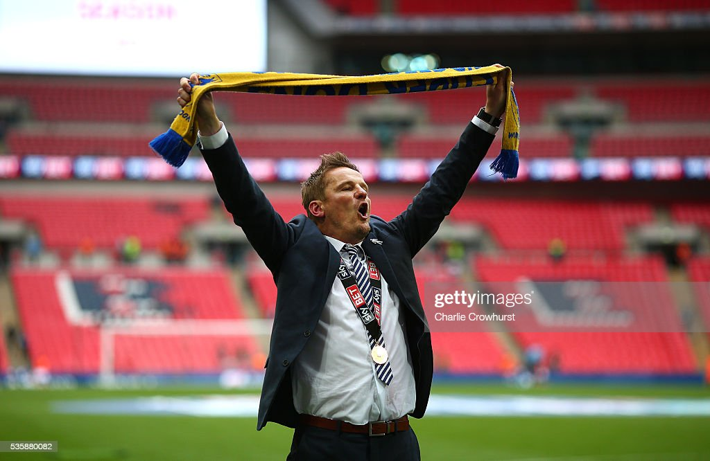 AFC Wimbledon's manager Neal Ardley celebrates the teams win and promotion during the Sky Bet League 2 Play Off Final between Plymouth Argyle and AFC Wimbledon at Wembley Stadium on May 30, 2016 in London, England.