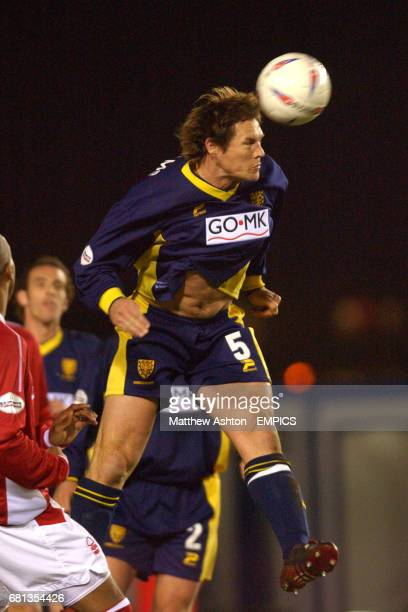 Wimbledon's Mark Williams clears with a powerfull header