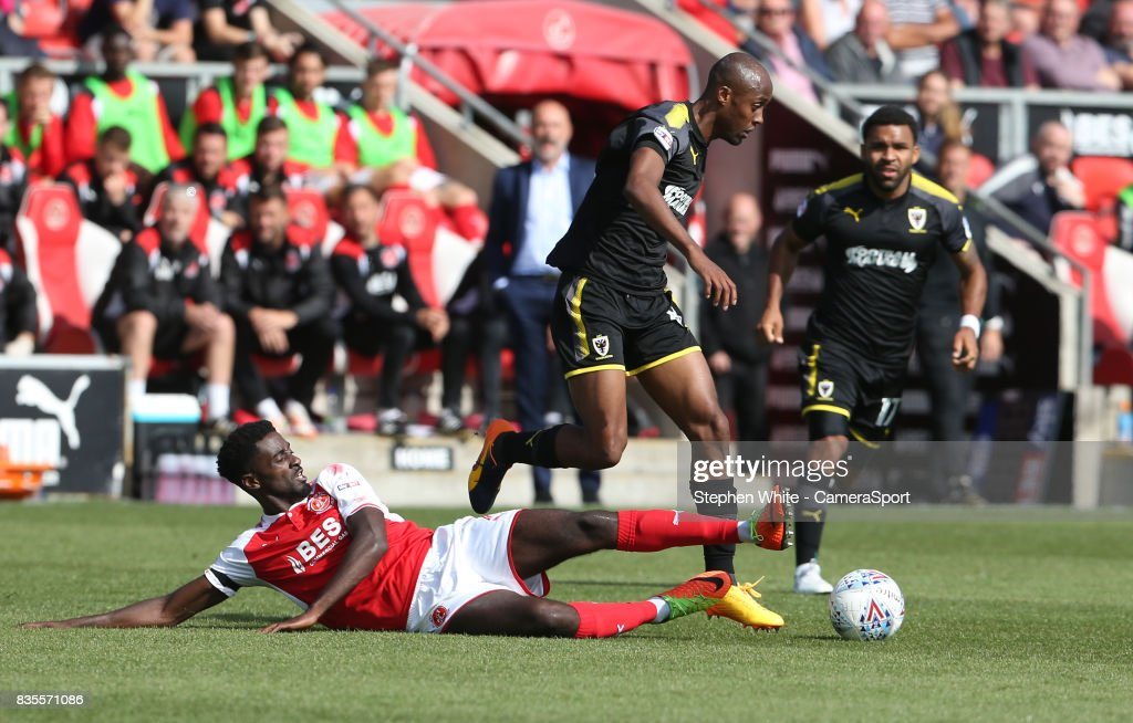 Wimbledon's Nadjim Abdou is tackled by Fleetwood Town's Jordy Hiwula during the Sky Bet League One match between Fleetwood Town and A.F.C. Wimbledon at Highbury Stadium on August 19, 2017 in Fleetwood, England.