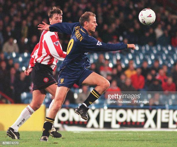 Wimbledon's Stale Solbakken races away from Southampton's Matt Le Tissier during today's Premiership match at Selhurst Park Photo by Stefan...