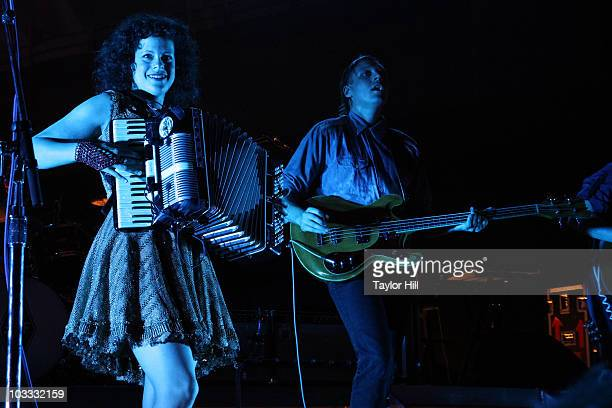 Win Butler and Regine Chassagne of Arcade Fire perform at the Ryman Auditorium on August 9 2010 in Nashville Tennessee