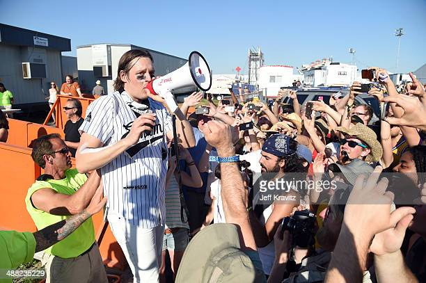 Win Butler of Arcade Fire performs during the 2014 New Orleans Jazz Heritage Festival at Fair Grounds Race Course on May 4 2014 in New Orleans...