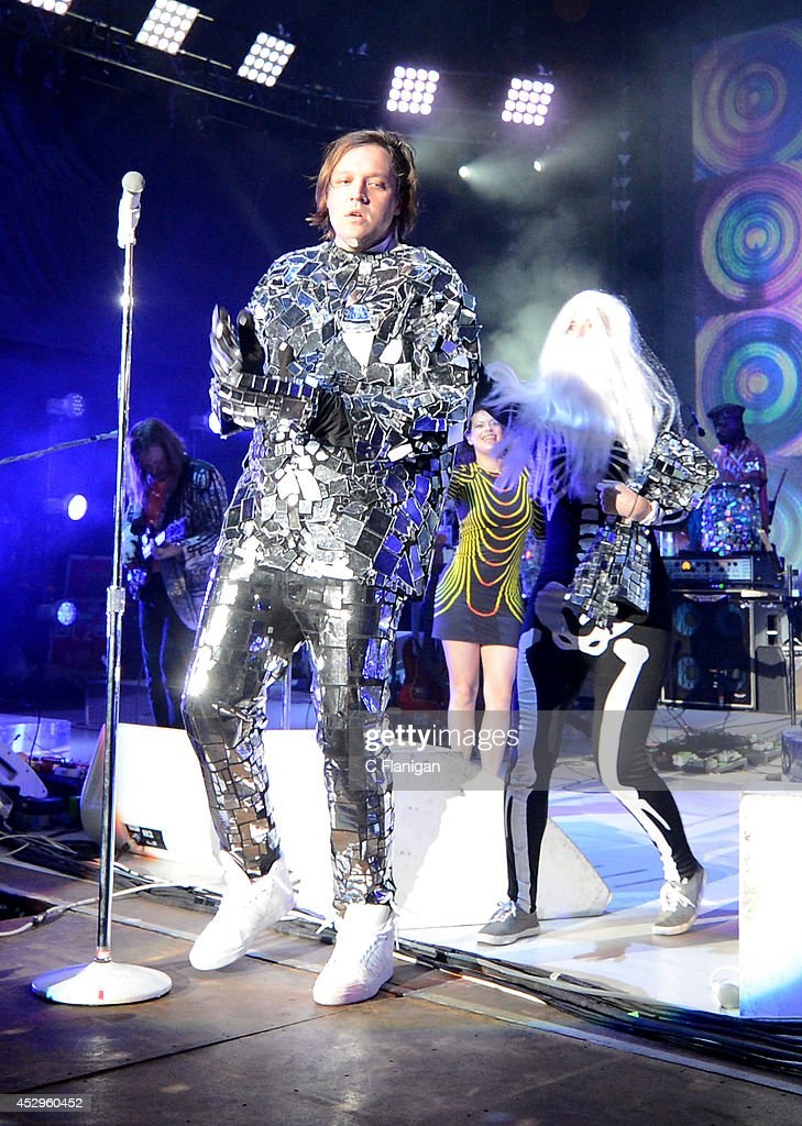 <a gi-track='captionPersonalityLinkClicked' href=/galleries/search?phrase=Win+Butler&family=editorial&specificpeople=2220917 ng-click='$event.stopPropagation()'>Win Butler</a> of Arcade Fire performs during the North American return of their Reflektor Tour at Shoreline Amphitheatre on July 30, 2014 in Mountain View, California.